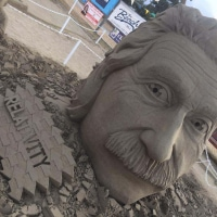 Couldn't resist gifting a BLESSED EARTH CRYSTAL to Einstein, at the Parksville Sandcastle comp on Vancouver Island, Bc